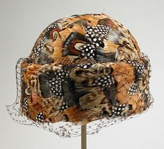 Woman's hat   United States, early 1960's   Adolfo (born Cuba, active United States) for Saks Fifth Avenue   Coq, pheasant, guinea feathers, wool felt, nylon net   Los Angeles County Museum of Art, LACMA