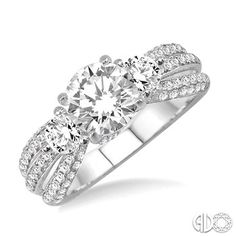 This marvelous ring is crafted in glistening 14 karat white gold and features 110 exquisite round cut accented diamonds that flow down the shank forming brilliant rows in pave and prong setting and designed to frame your choice of center stone ranging from .85 carat to 1.25 carat.  #Diamonds #SwansonDiamondCenter