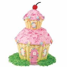 Home Sweet Home cake stands over 12 inches high! This dreamy two-story confectioners' cottage is made using our Dimensions® Large and Mini Cupcake pans.