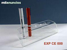 Expositor para cigarrillos electronicos en metacrilato tranparente. Capacidad para 6 cigarrillos.Disponibilidad inmediata.