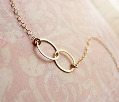 Two Circle Bracelet on Uncovet - Two circles intertwine to create the perfect bracelet