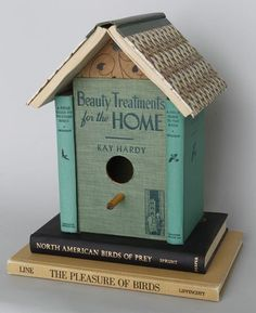 birdhouse made from old books. Tons of repurposed book ideas here...a book clutch, clock, rug, headboard, shelves & more. So many great ideas here!
