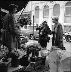 Karen Blixen (Isak Dinesen) and her loyal secretary, Clara Svendsen (Selborn) buying flowers on Højbro Plads