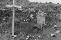 """""""Sleeping here a brave air-hero who lost youth and happiness for his Mother land. July 25 - Nippon Army"""" Grave marker of an American airman killed in combat and interned by the Japanese Army Kiska Aleutian Islands US Territory of Alaska."""