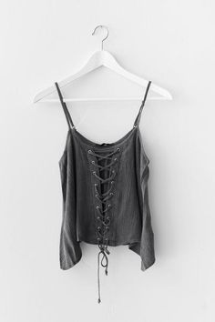Charcoal tank top with a lace-up front and cropped fit. Lightweight non-stretch woven material. Adjustable spaghetti straps.  100% Rayon Imported