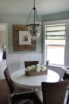 Love the white round table and the wicker chairs.