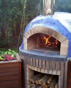 Pebble Blue Cloud Porcelain Mosaic covering a wood-fired oven. Available at Homedepot.com