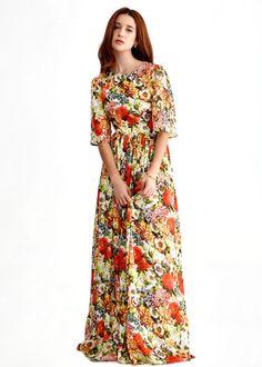 FloralMaxi vestido con caida y estampado floral en tonos naranjas. Cuesta 179 €.