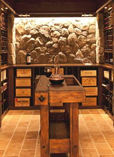 Gorgeous stone wine cellar with wine crate shelving
