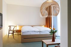 Hotel Bellevue Adelboden / Bernese Oberland offers over 50 double and single rooms and suites. Adelboden, Hotel Meeting, White Building, Boutique Design, Workout Rooms, Timeless Elegance, Cool Rooms, Living Area, Contemporary Design