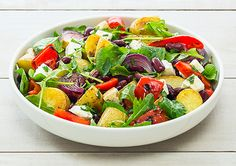 The Roast Potato, Onion and Red Capsicum Salad is ideal for an affordable side to your Christmas main.