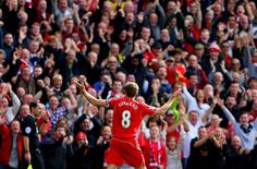 Steven Gerrard of Liverpool infront of the home fans after scoring the opening goal from a free kick during the Barclays Premier League match between Liverpool and Everton at Anfield on September 2014 in Liverpool, England. Liverpool Team, Liverpool Legends, Liverpool England, Football Troll, Football Jokes, Stevie G, Barclay Premier League, Football Photos, Free Kick