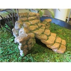 "Garden Stairs - $11.00  Stone looking stairs curve and rise to 2.5"" tall and 5.75"" wide. The stone wall can be used with the stairs for a great retaining wall look."
