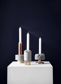 Tall Stuart stands tall with a smooth concrete, textured copper and a light wood base. Playing with concrete, steel and copper, David has turned the Crowd Candle Holder into much more than just a candle holder. With their industrial and rough appearance, they look like material experiments or miniature installations, as a result of a clash between art and design. Design David Taylor Dimensions H: 170 x Ø: 90 mm IN STOCK FROM JUNE 2016
