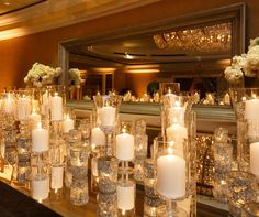 All it takes is a touch of sparkle to take black and white to another level. Mirrored tables, sparkling candles and dramatic lighting set the scene for a truly elegant wedding celebration. Tables lit from beneath give the reception a modern edge. And what out-of-this-world after-party would be compl