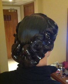 A thick ring of swirls makes this a great look if paired with the right dress. This would complete the gypsy dancer look for latin, especially Paso Doble. Visit http://ballroomguide.com/comp/hair_make_up.html for more hair and makeup info