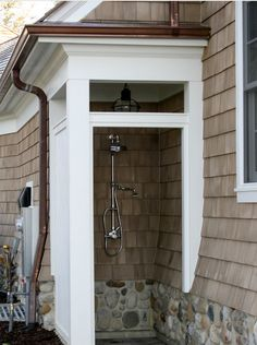 outdoor shower, stone foundation, onion cape cod lantern, copper gutters