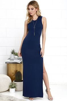 Don't underestimate the power of a chic dress like the Shield and Sword Navy Blue Sleeveless Maxi Dress! Jersey knit tops a fitted, sleeveless bodice that extends down the body to a maxi length, but not before showing off some leg with a high side slit. Kangaroo pocket at front.
