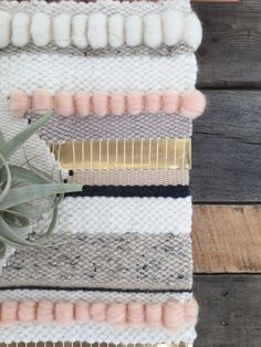 Large handmade woven wall art with air plant by SunWoven on Etsy - love stripes with roving for texture
