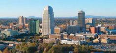 This is such an awesome photo of Winston-Salem!  The first time I've seen it from this viewpoint, with such a clear view of Pilot Mountain in the background.