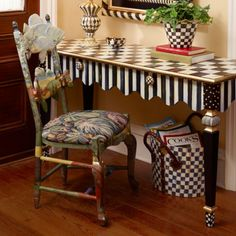 Standout style. Courtly Checks® and Courtly Stripes, rich with texture and infused with color, as only our artisans can do. The beautifully proportioned Courtly Stripe Console Table features a graceful scalloped-edge apron, corner blocks studded with gold beads, and carved legs that offer our artisans a chance to play with solids, stripes, and dots. The cleverly disguised drawers are opened with handcrafted Courtly Check® ceramic knobs. Handcrafted in Aurora.