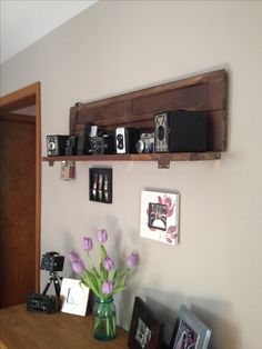 Found this old shutter, added a few L brackets, and voilà....a cool shelf to display my vintage camera collection!