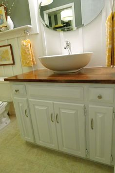 We took out old countertop and replaced it with stained and sealed butcher block