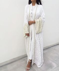 """If you are looking for an abaya to wear at your wedding then this is the one for you! Exquisite hand embroidery and hand finished """"Chikan kari"""" silk lined abaya with hand beaded sleeve detailing, perfect for your big day. Limited Edition Abaya"""
