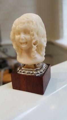 Oriel: portrait bust. Tagua, silver and teak. By Andrew Birks