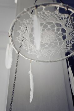 Hang a dreamcatcher to where it's face is pointed toward the ground, and made a beautiful mobile to hang over the babies crib