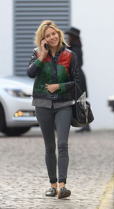 Bold in brights: Sienna Millerstepped out in a funky colour-block jacket for a spot of re...