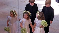 Just before the bride arrived, the bridesmaids and pageboys were ushered in by Kate, who helped coax them into their positions with an encouraging hand on their shoulder