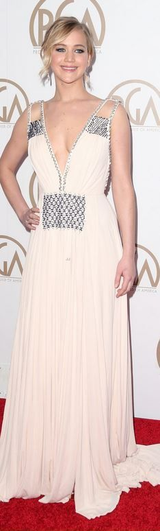 Jennifer Lawrence: Dress and shoes – Prada  Earrings – Irene Neuwirth  Rings – Shay