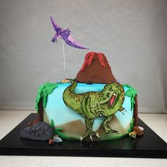 T-Rex Dino cake. Gluten free and entirely edible. Hand painted gum paste Dinos and rice crispy treat volcano.