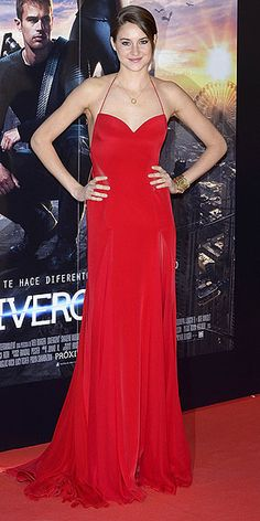 Last Night's Look: Love It or Leave It? | SHAILENE WOODLEY | Shailene gets colorful on the red carpet in a poppy-red silk-and-chiffon gown from Donna Karan Atelier at the Madrid premiere of Divergent, adding a touch of gold with a J Lynn Jewelry pendant necklace.