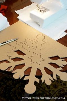 Decorating our old Victorian home for Christmas… I'm going to cover these DIY cardboard snowflakes with German glass glitter.