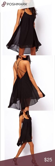 Beautiful Black Chiffon Mini Dress with Strap Back Hipster chiffon black dress with backless sling strap. This asymmetrical dress has a very flattering cut. It's transparency adds to its sexy silhouette. Buy this dress and I'll include the Forever Summer Necklace for free Dresses Mini