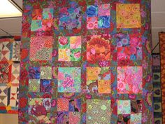 Kaffe quilt..  Gives me some ideas on how to use some of my Kaffe stash! Really like the way the large prints are showcased and the border