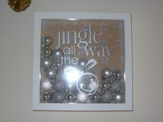A shadow box frame makes a lovely xmas decoration for the wall