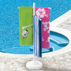Swim towel rack....using an umbrella stand.  Definitely on my to do list