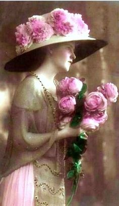 photo of lovely vintage lady wearing a pink rose-covered huge hat carrying a rose bouquet (via Pinterest)