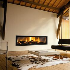 To compliment the Neofocus open wood burning fire the Gigafocus is a stunning glass fronted wood burning fire. The width of the fire exposes the red hot flames allowing them to be seen with candid optimism and with a choice of 3 widths available 1500mm, 1700mm & 1900mm there should be one to suit most rooms. The Pyroceramic glass door will slide up into the recess allowing full view of the fire but it can also be dropped down 45° for cleaning.