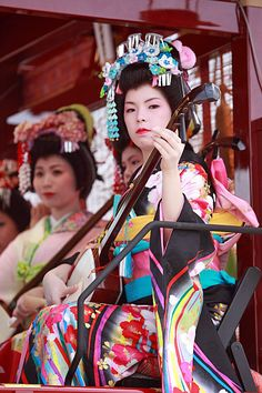 "Hibuse Festival :  She is a playing a ""shamisen""(a three-stringed Japanese banjo)"