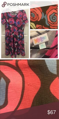 LuLaRoe 2XL Amelia Disney Roses!! Rare and HTF!!! EXTREMELY RARE AND HTF PRINT!!!! 2XL Disney Rose Amelia Dress!! Worn once and laundered according to instructions. EUC other than a small pull in the fabric towards the bottom (see picture #2) ABSOLUTELY STUNNING!! I am open to REASONABLE offers but I did pay over retail for this. LuLaRoe Dresses