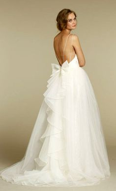 An elegant, simple strap bodice that leads down toward a eye-catching, delicate bow at the waist which cascades to the floor. For more inspiration visit www.weddingsite.co.uk