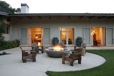 via Home Adore, designed by Charles DeLisle. Firepit, nice for family & friend times.
