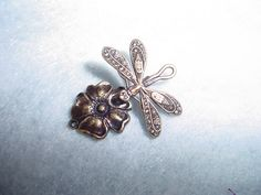 Dragonfly with flower clasp.