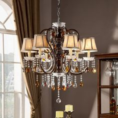 @Overstock.com - These stately and ornately designed hanging crystal ceiling lights will transport you to another time and place. Illuminate your home with eight incandescent bulbs housed in mini bell lamp shades with tea crystals gracefully falling to catch the light.http://www.overstock.com/Home-Garden/Clarissa-Tea-Crystal-Ceiling-Lamp/6643824/product.html?CID=214117 $269.99