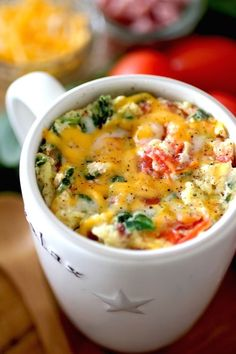2 Minute Omelet in a Mug - egg &/or egg whites, unsweetened almond/other milk, salt & pepper, Roma tomato, shredded 2% cheddar/other cheese, optional mix ins (lean cubed turkey/ham/ground sausage, cooked crumbled center cut bacon, red bell pepper, fresh spinach leaves, fresh chives, vegetables of choice)