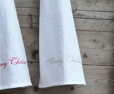 Merry Christmas embroidered white linen kitchen towel by leonorafi